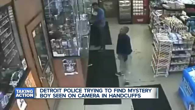 DPD seeking help identifying boy in handcuffs