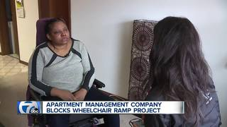 Handicapped woman blocked from building ramp