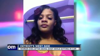 Woman fatally shot while inside car in Detroit