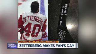 Zetterberg spills fan's beer, then gifts a stick