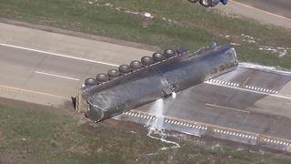Tanker truck dumps milk load in crash
