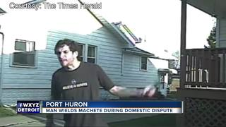 VIDEO: Man threatens police with machete
