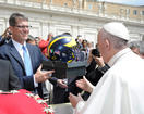 U-M football coach in Rome, slips Pope a helmet