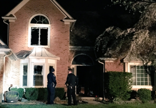 Family member arrested in deadly house fire