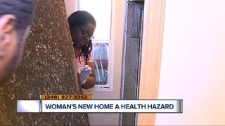 Woman says new home has dangerous black mold