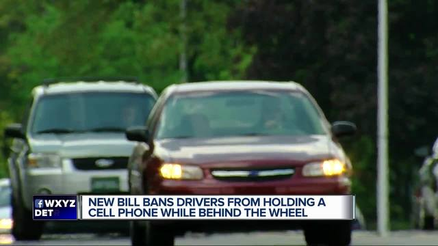 michigan state bill could prohibit drivers handheld