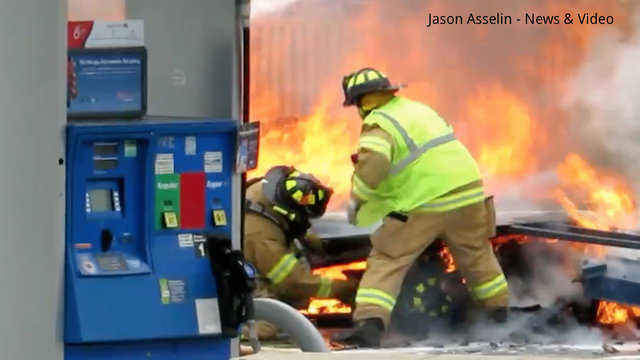 Dramatic video shows Michigan firefighter under burning gas station
