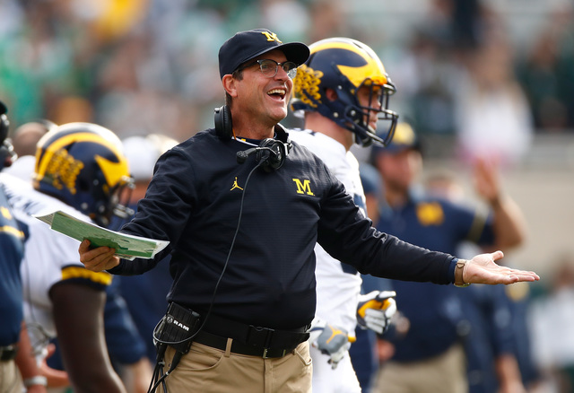 Jim Harbaugh assists with calf birth during visit to IN farm