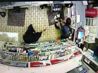 Caught on camera: Young mom robbed at gunpoint