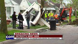 Firefighters on the scene of house explosion