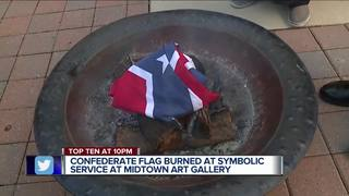 Local gallery burns Confederate banner