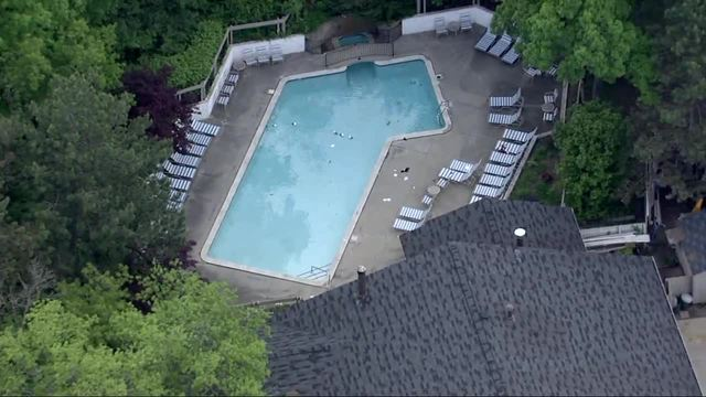 Man, 3-year-old son dead after being found in MI pool