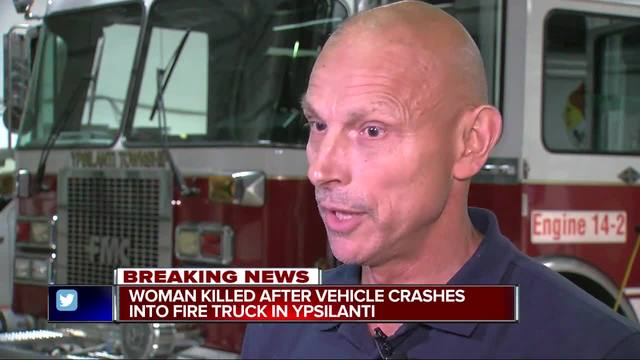 Girl dies after SUV hits firetruck in Michigan