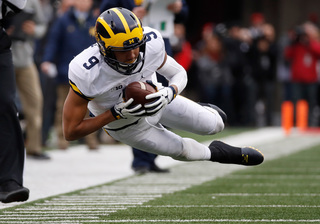 U-M's Perry back with team as he awaits trial