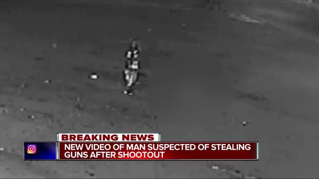 Police release video of suspect wanted for taking wounded officer's gun