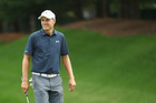 Spieth holes bunker shot, wins Travelers playoff