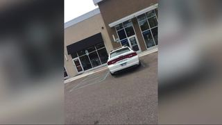 DPD investigating squad car in handicap spot
