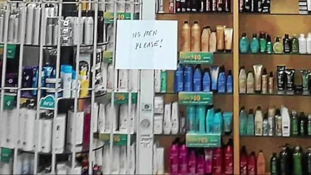 Salon under fire for 'no men please' sign