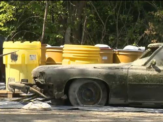 Human remains found inside car pulled from pond