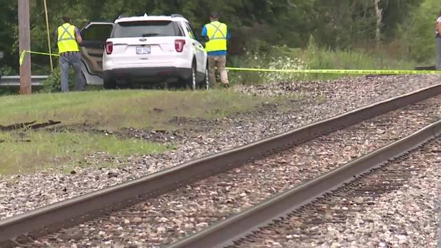 Police find body believed to be suspect on railroad tracks