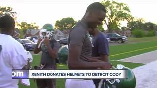 Cody football gets surprise: new helmets