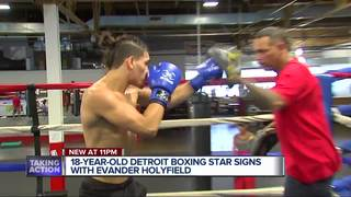 Undefeated boxer signs with Evander Holyfield