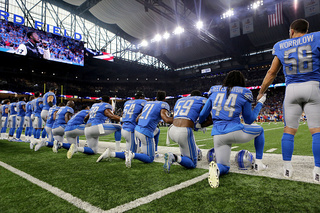 Lions players kneel during national anthem