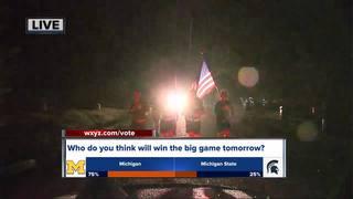 UM & MSU ROTC members run game ball to Ann Arbor