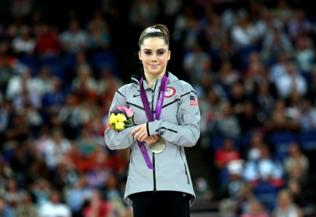 Gymnast says she was forced to keep abuse secret