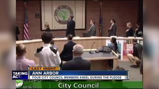 4 Ann Arbor council members kneel for pledge