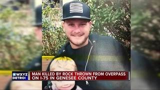 Man hit by rock thrown from overpass dies in car