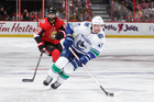 Big 2nd period lifts Canucks to win over Detroit