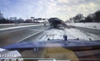 Video shows car slam into truck on freeway