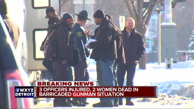 Gunman barricaded after 2 women killed, officer wounded
