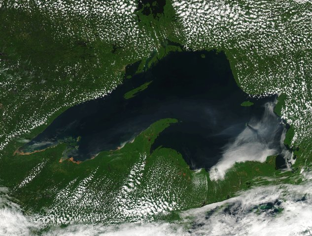Image shows mud flowing into Lake Superior
