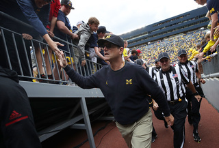 Harbaugh admires Tiger Woods' over-40 success