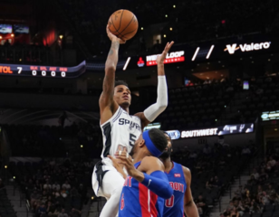 Early run helps Spurs pull away from Pistons