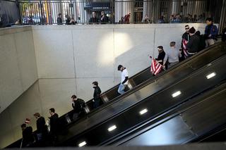 Man strangled after shirt caught in escalator