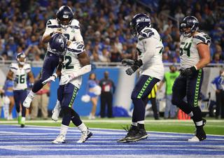 Wilson, Carson lift Seahawks over Lions