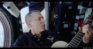 Local astronaut records music video from space