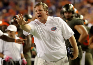 Michigan adds Jim McElwain as assistant
