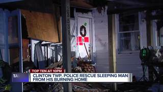 Police wake man sleeping in burning house