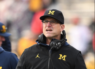 Threatening tweets tagging Harbaugh investigated