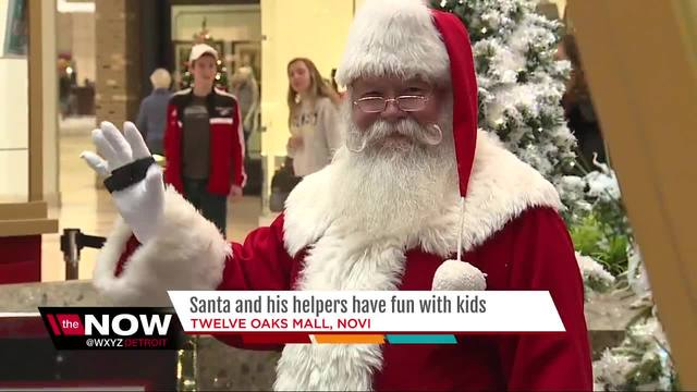 Santa and his helpers have fun with kids at 12 Oaks Mall