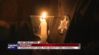 Wife of slain deputy calls large vigil 'amazing'