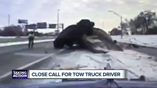 Tow truck driver talks about brush with death