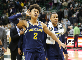 No. 22 Michigan tops No. 8 Ohio State, helps MSU