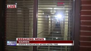 About 100 evacuated after fire at Warren hotel