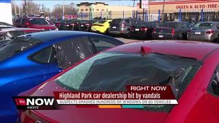 Vandals bust hundreds of car windows at dealer