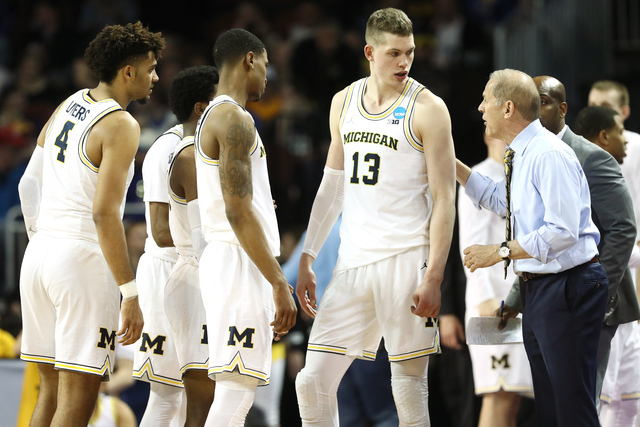 Poole's buzzer-beating 3-pointer lifts Michigan over Houston 64-63